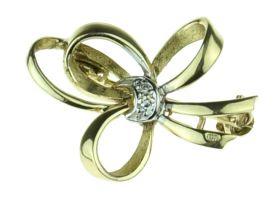 14 karaats gouden strikbroche met diamantje